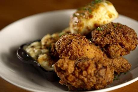 Buttermilk fried chicken with mac and cheese and biscuit.